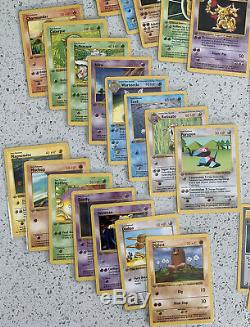 Near complete lot of 63 x Base Set 1st Edition Grey Stamp Error Non holos LP-NM